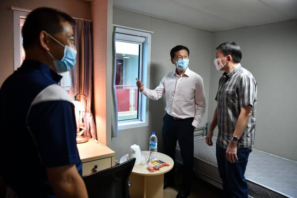 From left, MPA Academy Dean Tan Suan Jow, Minister of Transport Ong Ye Kung and Senior Minister of State for Transport and Foreign Affairs Chee Hong Tat looking at a room inside the Crew Facilitation Centre at Tanjong Pagar Terminal.
