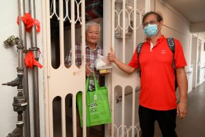 Brother Cheh Yong Seng seen here giving a resident a care bag