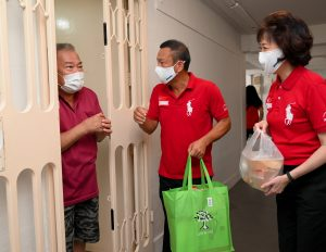 Brother Yong Soon Huat and Sister Mary Liew seen here engaging in short conversation with a resident